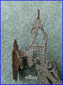 1700s Antique cast iron wall-mounted pivoting candle holder extremely rare