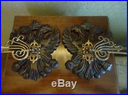 A pair of decorative candle holders, dark wood & brass, wall sconce
