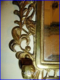 Antique Cast Brass Wall Mirror with (removable) Swivel Candle Holders. 9543